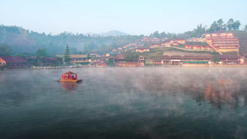 Aerial drone sky view flying in misty morning at Ban Rak Thai, a Chinese settlement in Mae Hong Son province, Northern Thailand. | Shutterstock HD Video #1053297677