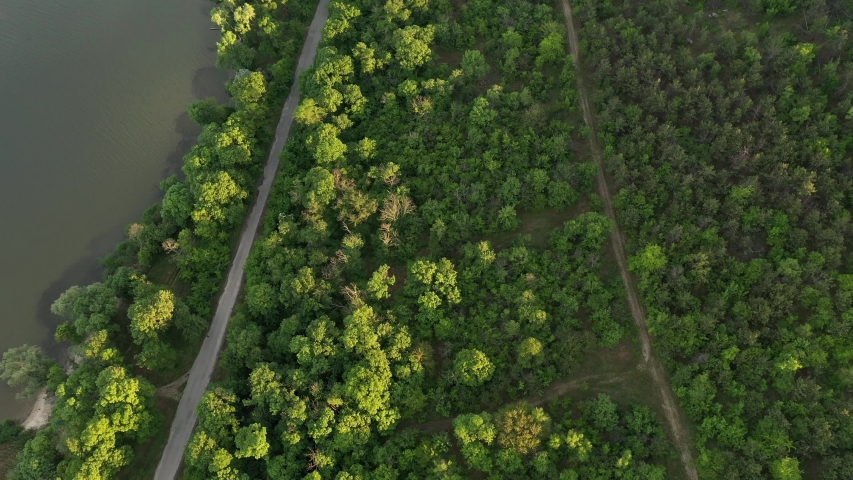 River aerial landscape footage during sunset. Fly over forests and river | Shutterstock HD Video #1053308399