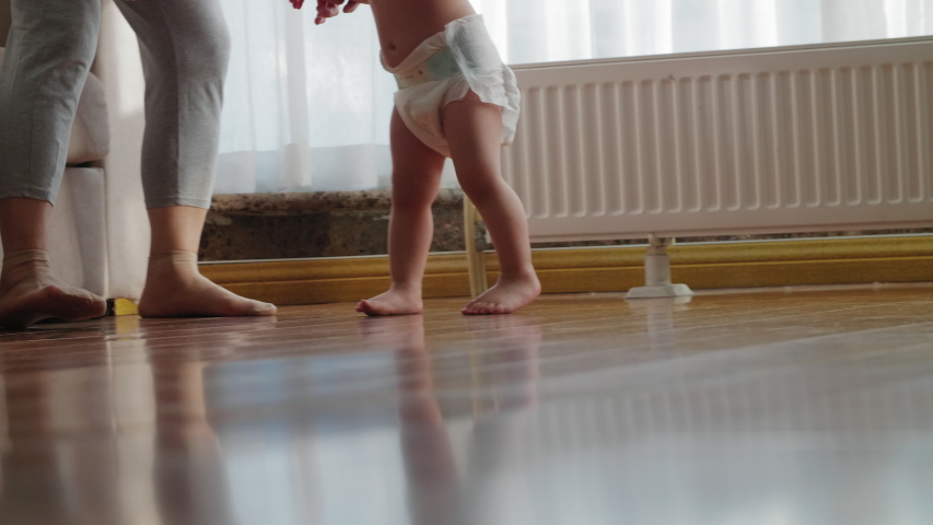 Close up of asian baby bare foot girl walking at home on the floor
