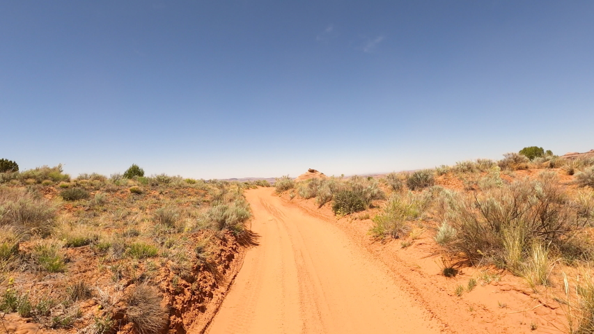 MOAB, UTAH - 20 MAY 2020: 4x4 off road recreation desert sandy trail UTV Moab Utah POV. Tourists worldwide come to Arches, Canyonlands National Parks. Off road recreation, 4x4 rock trail climbing.