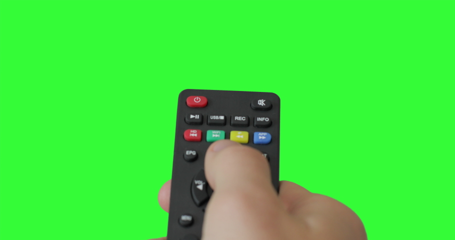 Isolated Male hand with TV remote pressing button and changing, switch channels. Green screen. Place for your advertisement. Pack of Gestures. Using a remote control over keyed chroma key background | Shutterstock HD Video #1053334808