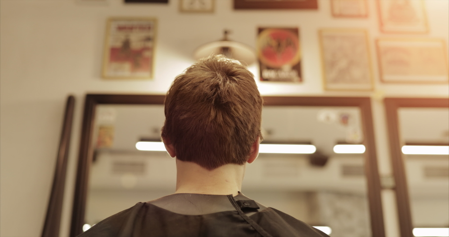 Barbershop in new conditions. Haircut in a beauty salon. Haircut clipper and scissors. Slow motion 4k | Shutterstock HD Video #1053341816