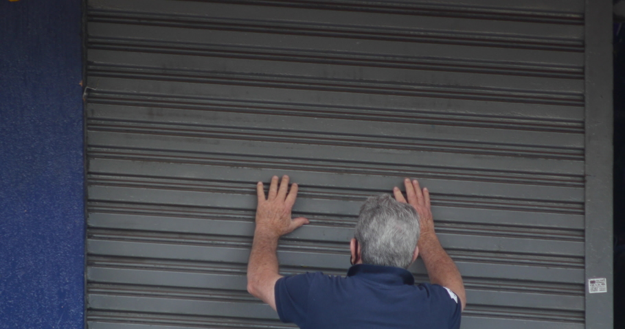 SAO PAULO, BRAZIL, May 28th 2020: Man opening shop store after coronavirus lockdown, Sao Paulo, Brazil , covid 19, quarantine, isolation, social distance