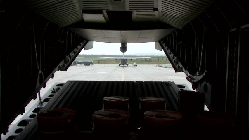 Closing military aircraft's baggage