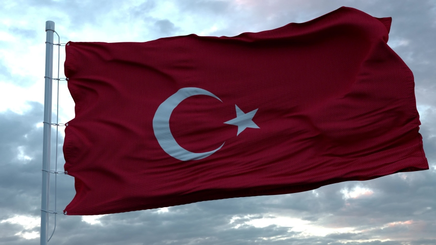 Flag of Turkey waving in the wind against deep beautiful clouds sky
