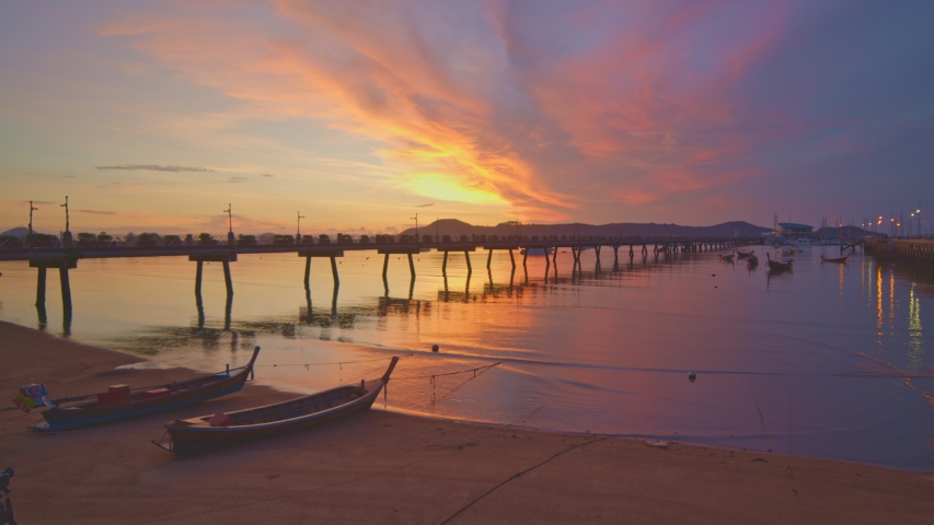 Scenery sunrise Chalong pier. Chalong pier very important for travel business it is a center for all boat  and yacht marina there have two piers for transport service tourists  | Shutterstock HD Video #1053360224