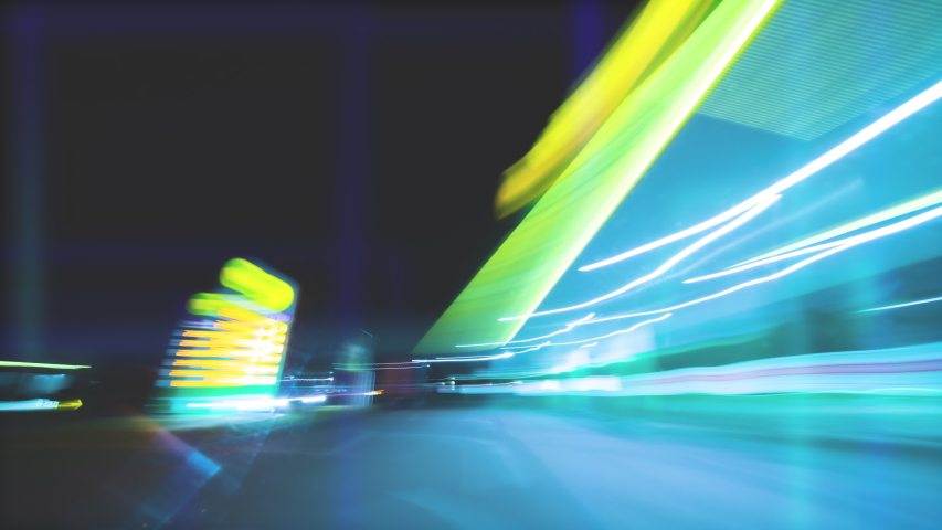 The car driving on the night city road. inside view. hyperlapse   Shutterstock HD Video #1053364139