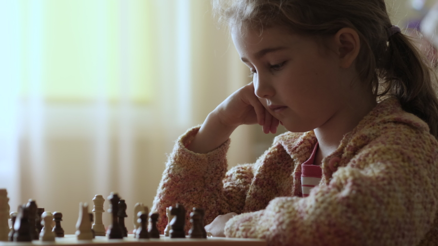 Portrait of Smart Little Girl Playing Chess. Child Playing Chess With Friend at Home, Development of Logical Thinking for Children. Intellect, Intelligence. Development Logical Thinking. Slow Motion. | Shutterstock HD Video #1053364301