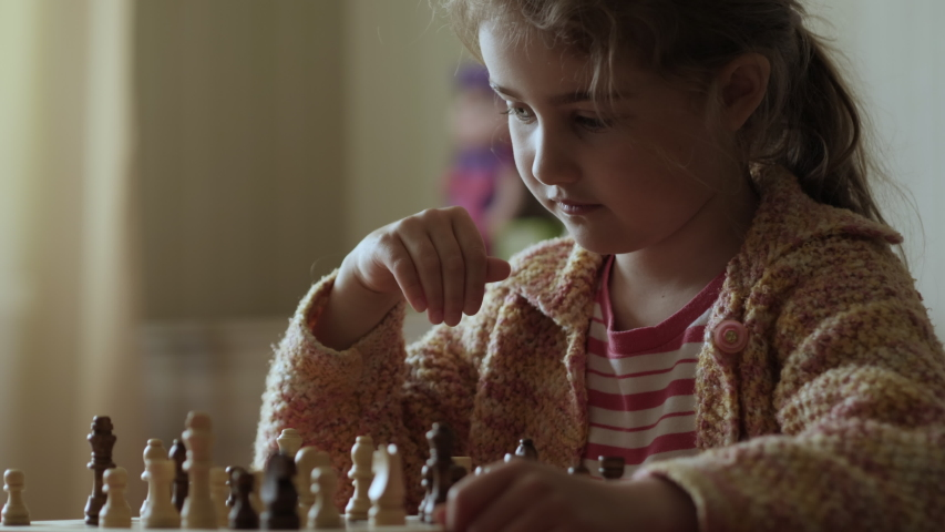 Portrait of Smart Little Girl Playing Chess. Child Playing Chess With Friend at Home, Development of Logical Thinking for Children. Intellect, Intelligence. Development Logical Thinking. Slow Motion. | Shutterstock HD Video #1053364310