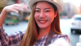 Traveler Asian blogger women travel in Bangkok, Thailand, beautiful female using mobile phone make vlog and live in social media .woman tourist making video call with smartphone while traveling.