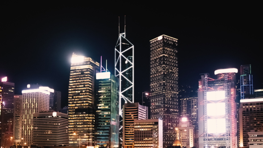 Hong Kong Central skyline at night - skyscrapers neon lights timelapse | Shutterstock HD Video #1053372341