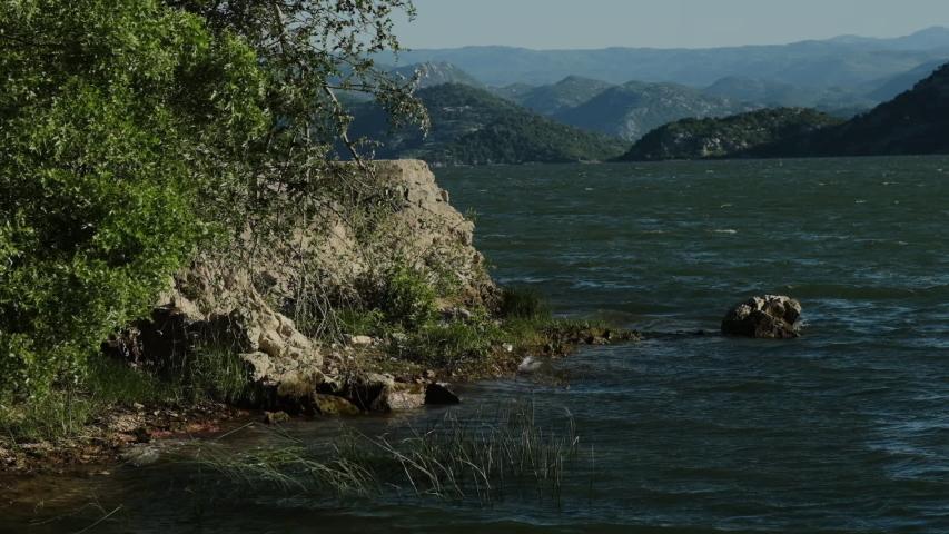 Strong wind on the scadar lake in montenegro  | Shutterstock HD Video #1053372701