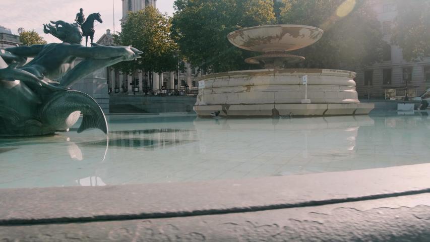 Fountain in empty Trafalgar Square in London during lockdown | Shutterstock HD Video #1053376811