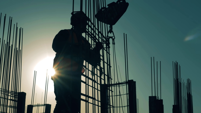 Professional contractor works with carcass on sunset background. | Shutterstock HD Video #1053379754