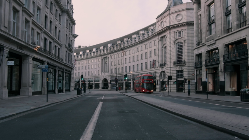 Bus driving in empty London streets during Covid19 Royalty-Free Stock Footage #1053384059