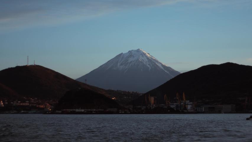 Frame mountains, volcanoes, ocean sea port coast Kamchatka | Shutterstock HD Video #1053390299