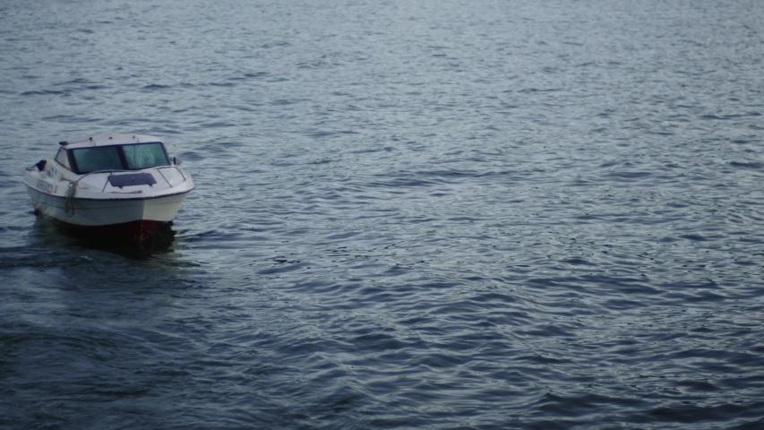 Sea, water waves boat in Kamchatka | Shutterstock HD Video #1053390344