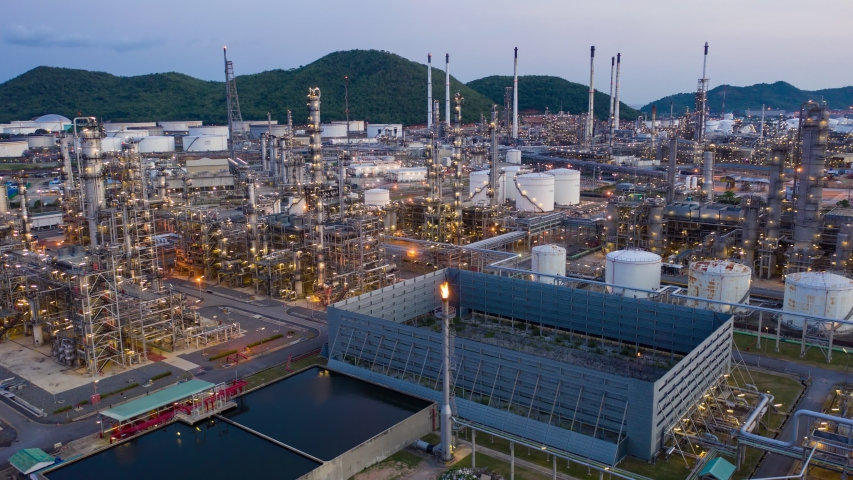 Hyperlapse Timelapse Aerial view drone of oil refinery terminal is industrial facility for storage of oil and petrochemical. oil manufacturing products. power electric plant. footage b roll time lapse | Shutterstock HD Video #1053390776