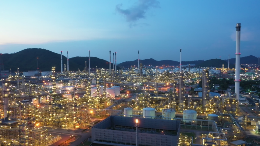Aerial view footage B roll light oil terminal is industrial facility for storage of oil and petrochemical. oil manufacturing products. power electric plant. low light. Footage b roll drone shot 4k. | Shutterstock HD Video #1053390779