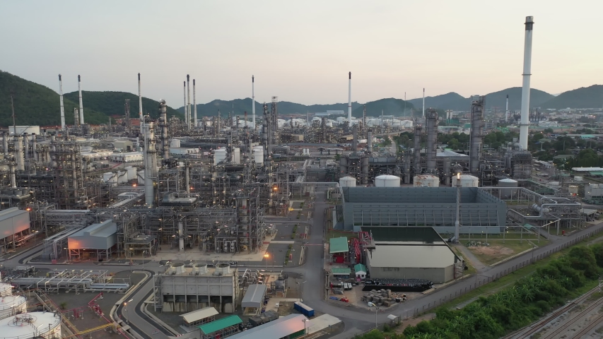Aerial view footage B roll light oil terminal is industrial facility for storage of oil and petrochemical. oil manufacturing products. power electric plant. low light. Footage b roll drone shot 4k. | Shutterstock HD Video #1053390788