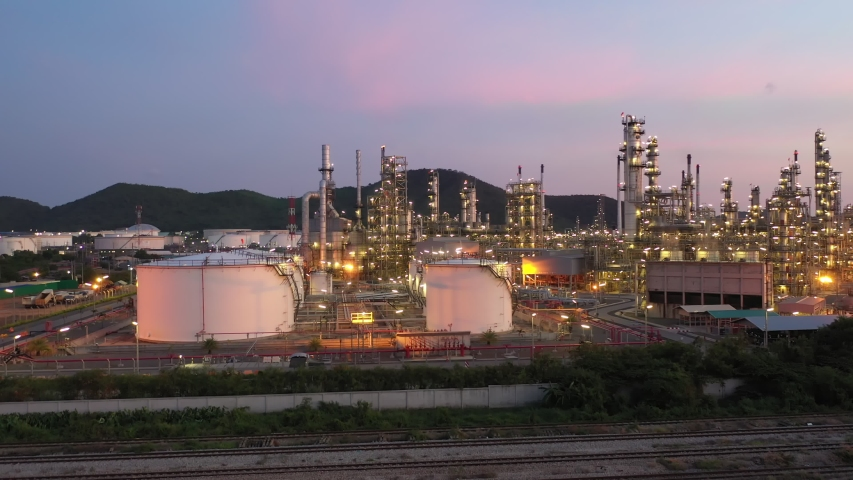 Aerial view footage B roll light oil terminal is industrial facility for storage of oil and petrochemical. oil manufacturing products. power electric plant. low light. Footage b roll drone shot 4k. | Shutterstock HD Video #1053390791