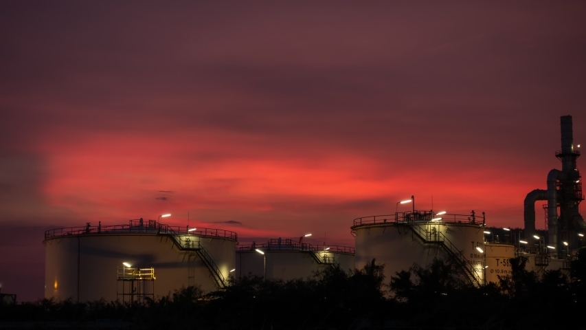 TimeLapse manufacturing oil refinery terminal is industrial facility for storage of oil and petrochemical. oil manufacturing products. power electric plant. Time lapse Day to Night b roll video 4k. | Shutterstock HD Video #1053390794