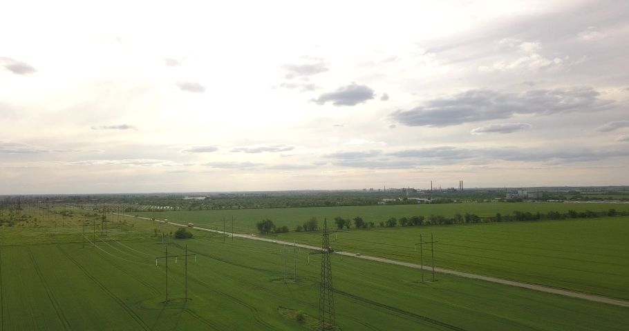 High flight in the country near large pylons of power lines, near the road | Shutterstock HD Video #1053395861
