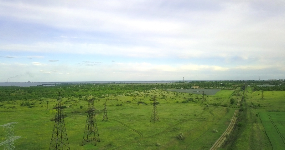 High flight in the country near large pylons of power lines | Shutterstock HD Video #1053395873