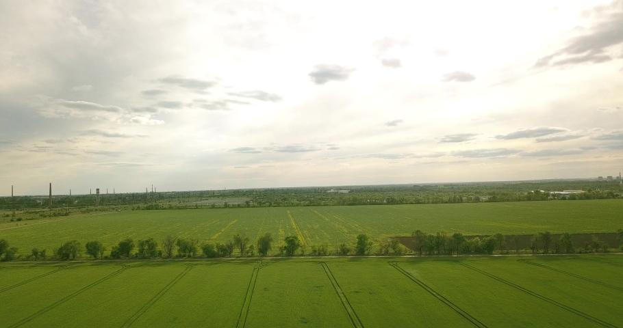 High flight over green fields | Shutterstock HD Video #1053395879