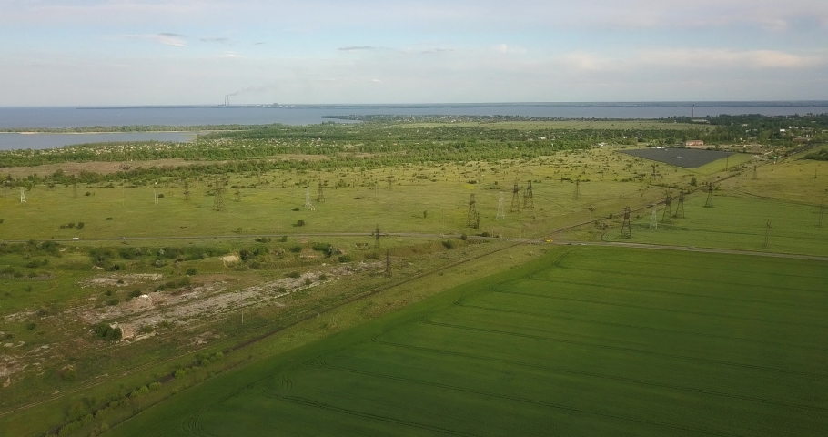 Large and green expanses of fields from a height, near the road | Shutterstock HD Video #1053395903