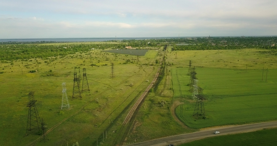 Large and green expanses of fields from a height and power poles | Shutterstock HD Video #1053395996