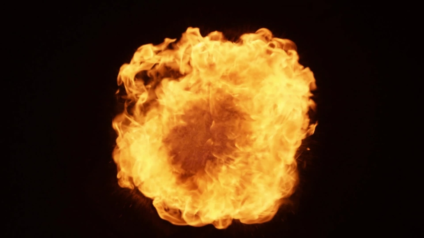 Fire ball explosion. Fire ball explosion towards to camera isolated on black background