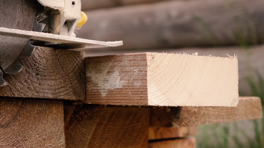 A worker saws wood with a circular saw. the concept of the construction | Shutterstock HD Video #1053402875