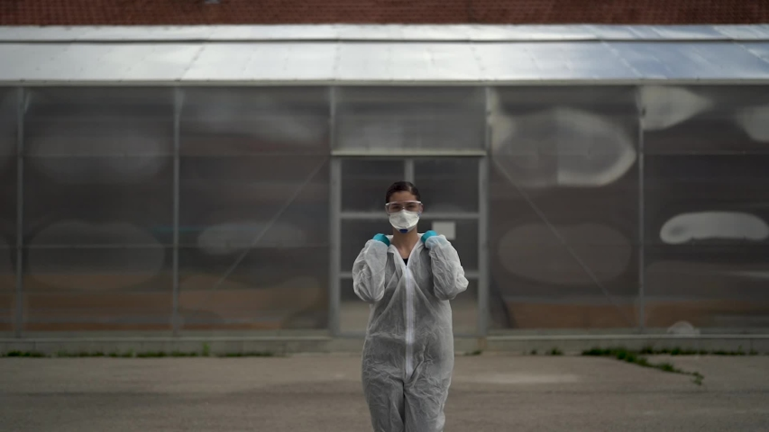 Equipped doctor waiting for patients in front of isolation ward medical facility.Coronavirus COVID-19 physician in PPE.City infectologist.Medical worker on the frontline | Shutterstock HD Video #1053409034
