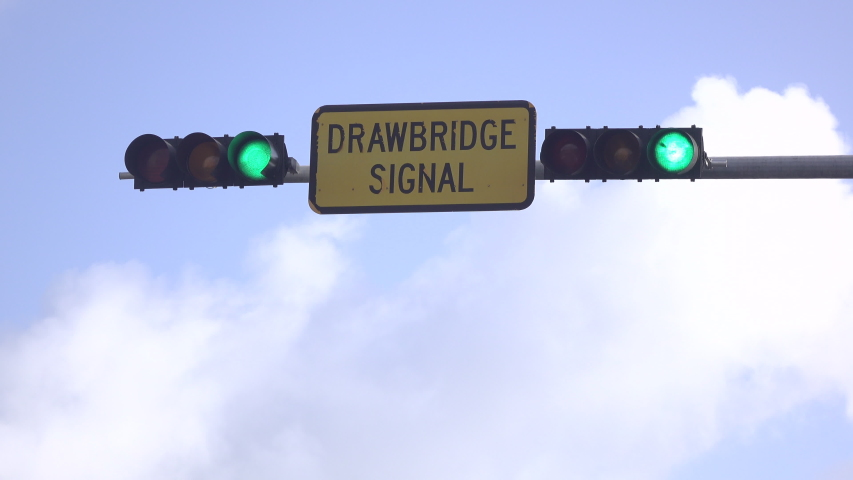 Drawbridge signal light on cloudy sunny day with blue sky background. | Shutterstock HD Video #1053412160