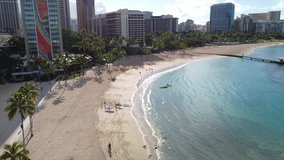 Cinematic aerial drone videos of vacant Waikiki Beach, amidst the backdrop of iconic Diamond Head.