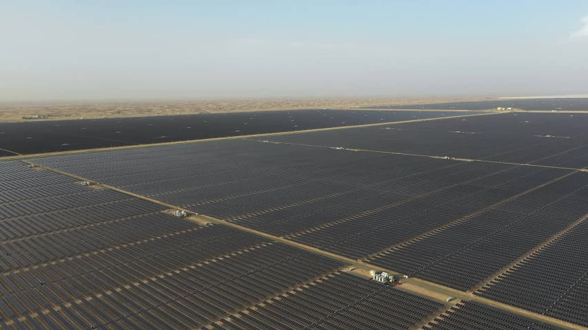 Aerial view of photovoltaic panels in a desert solar farm | Shutterstock HD Video #1053424883