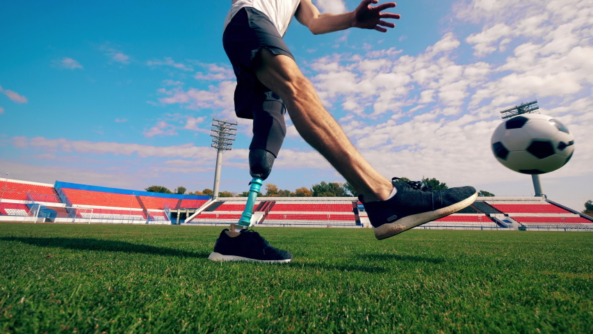 Sportsman with a bionic leg is hitting the ball
