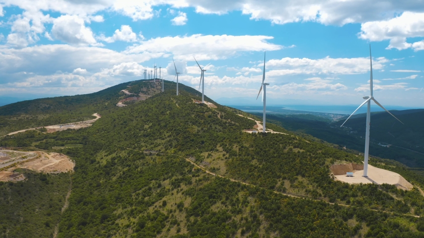 Aerial panoramic view of windmills in the hills. Amazing blue sky with white clouds on the background. Montenegro | Shutterstock HD Video #1053442619