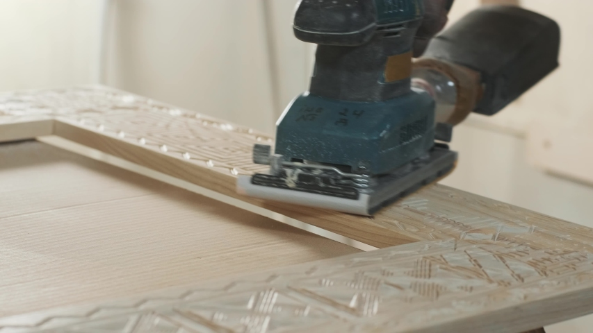 Wood sanding machines , Carpenter working with electrical sander on a surface | Shutterstock HD Video #1053445991
