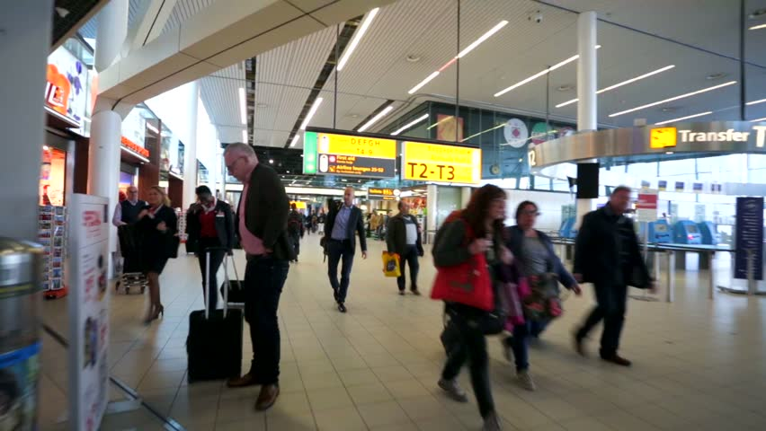 AMSTERDAM, NETHERLANDS - APRIL 28, 2015: Walk along Amsterdam Airport Schiphol. Schiphol - one of the biggest European airports, it was open on September 16, 1916.