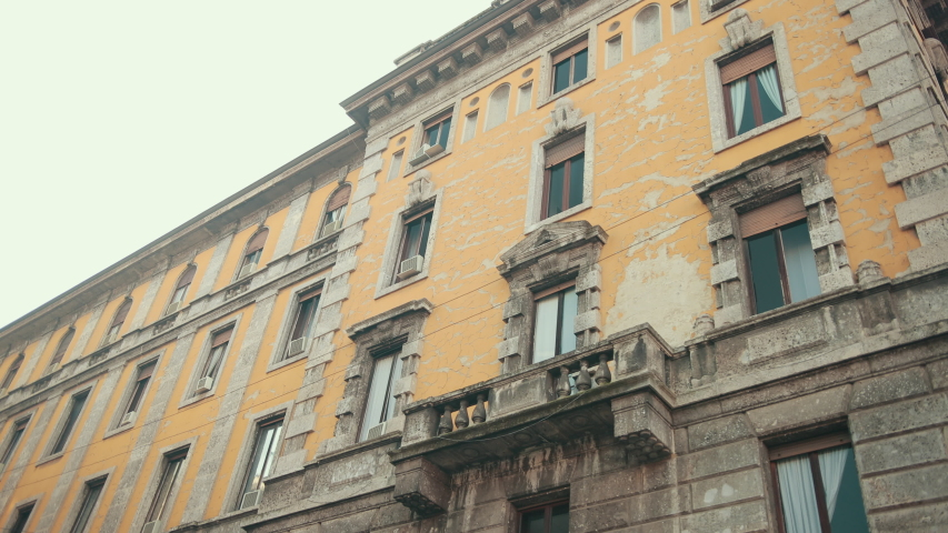 Abandoned Yellow Apartment Building In Italy, Milan, Lombardy, Cracked Plaster On Walls From Aging, The Building Needs Repair. A Lot Of Closed Windows | Shutterstock HD Video #1053455027