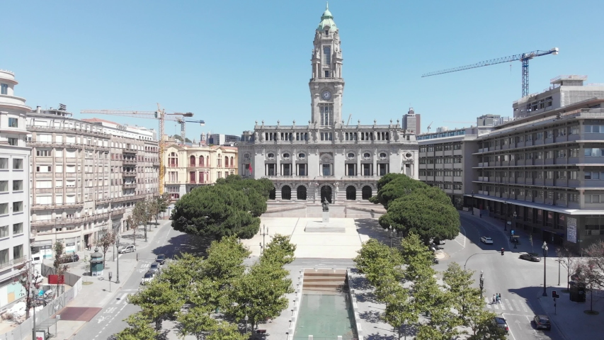AERIAL DRONE FOOTAGE - The Porto City Hall is perched atop the Avenida dos Aliados, or the Avenue of the Allies, on a line of Art Deco and Art Nouveau facades in Porto, Portugal. | Shutterstock HD Video #1053458039