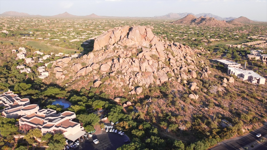 Ariel view of Boulders in North Scottsdale,CaveCreek & Carefree Arizona area.   Dolly in towards boulders, dramatic view of rugged desert landscape at early sunset. | Shutterstock HD Video #1053465212