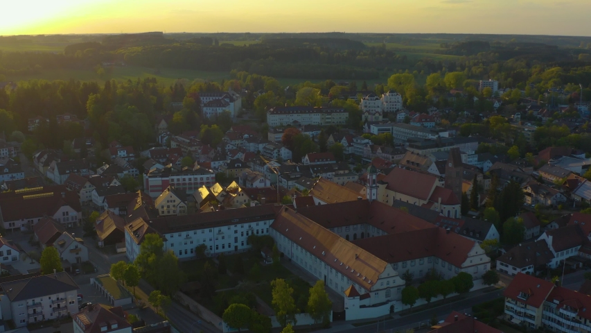 Aerial view of the city and monastery Bad Woerishofen in Germany, Bavaria on a sunny spring afternoon during the coronavirus lockdown. | Shutterstock HD Video #1053466427