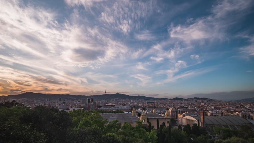 Daybreak timelapse of Barcelona city skyline. Pink sunset. Spain, 2020.