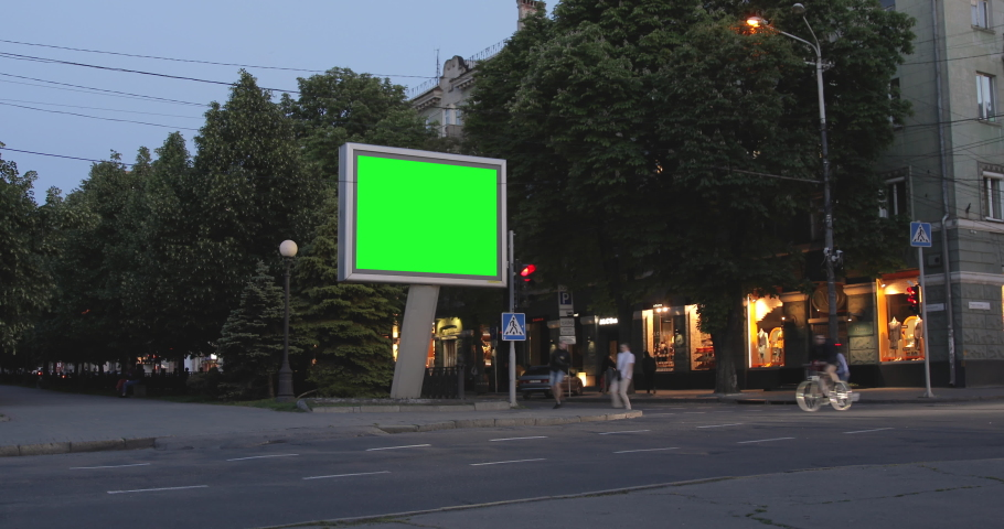 City street Billboard stand with chroma key green screen. Footage of downtown with commuters, people and cars. Copy Space for text or advertising.  | Shutterstock HD Video #1053479741