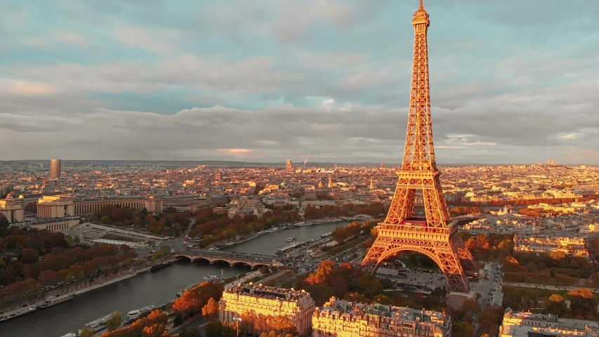 Aerial drone view of Paris Eiffel Tower Tour de Eiffel and panoramic view over Seine River and Paris city attractions at sunset