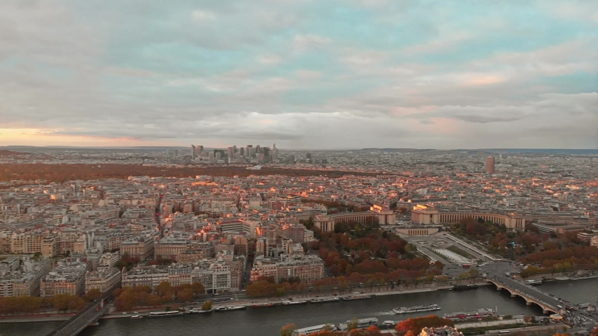 Aerial drone view of Paris Eiffel Tower Tour de Eiffel and panoramic view over Seine River and Paris city attractions at sunset    Shutterstock HD Video #1053482606