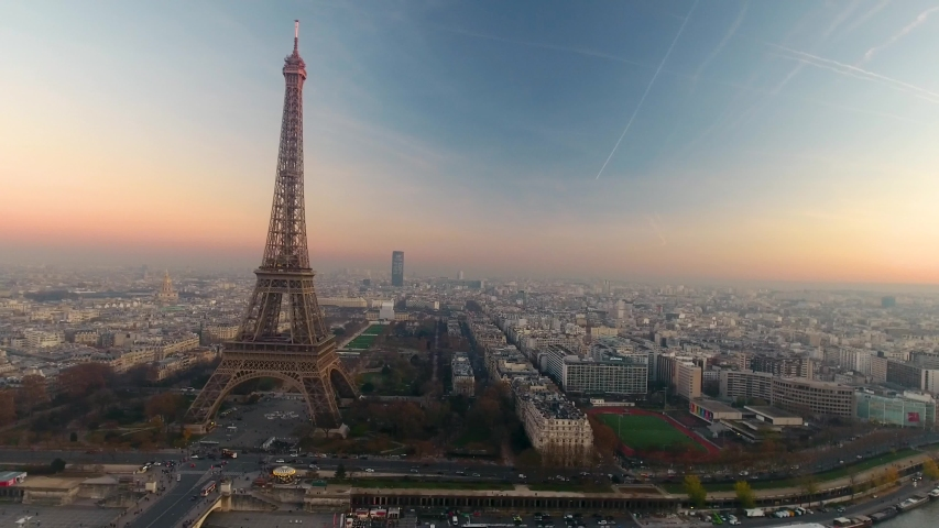 Aerial drone view of Paris Eiffel Tower Tour de Eiffel and panoramic view over Seine River and Paris city attractions at sunset  | Shutterstock HD Video #1053482612